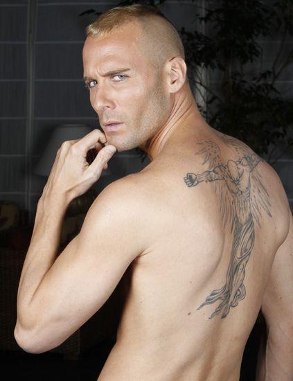 Ear, Finger, Skin, Shoulder, Tattoo, Facial hair, Chest, Barechested, Joint, Trunk,