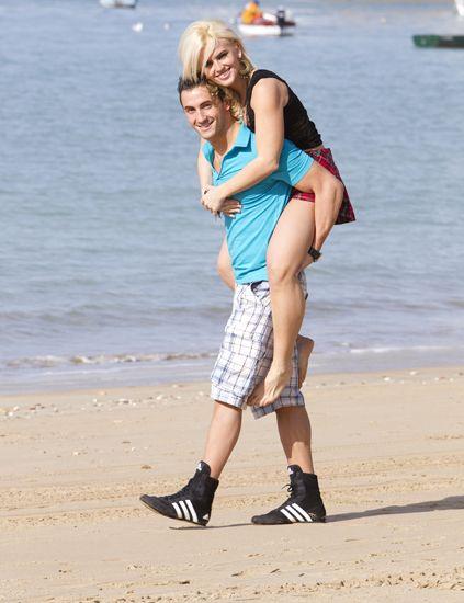 Human leg, Coastal and oceanic landforms, Beach, Tourism, Summer, Shore, Watercraft, People on beach, Knee, Sand,
