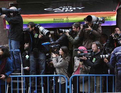 Camera, Cameras & optics, Video camera, Camera operator, Team, Jacket, Digital camera, Film camera, Fan, Photographer,