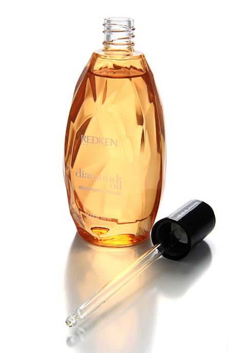 Fluid, Liquid, Bottle, Amber, Glass bottle, Perfume, Oil, Bottle cap, Chemical substance, Peach,