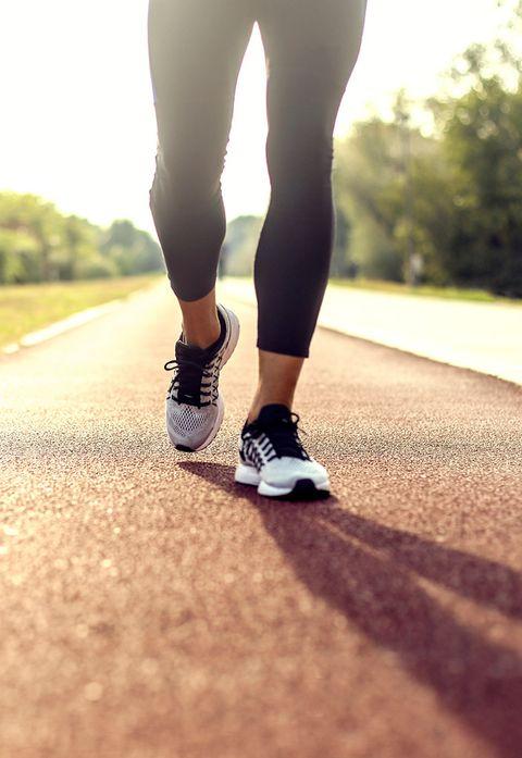 Human leg, Shoe, Joint, Asphalt, Athletic shoe, Knee, Calf, Active pants, Sunlight, Sneakers,