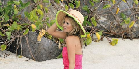 Hat, Skin, Human leg, Sand, People in nature, Summer, Sun hat, Beauty, Vacation, Thigh,