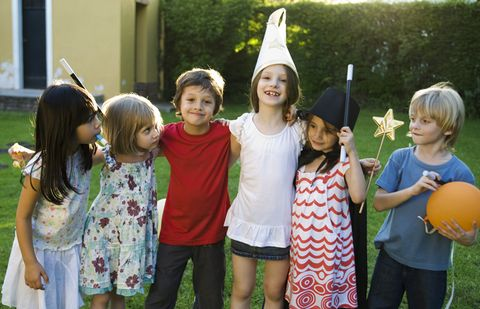 Face, Child, Costume accessory, Toddler, Party supply, Costume hat, Toy, Witch hat, Flag, Yard,