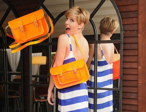 Shoulder, Bag, Orange, Luggage and bags, Shoulder bag, Travel, Street fashion, Sleeveless shirt, Blond, Stool,