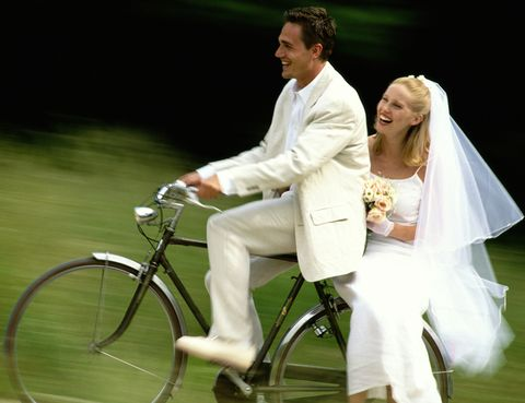 Bicycle wheel, Bicycle wheel rim, Bicycle frame, Bicycle tire, Shoe, Bicycle, Photograph, Bridal veil, Outerwear, Coat,