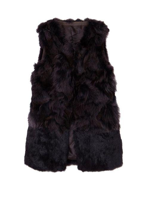 Textile, Natural material, Black, Woolen, Fur clothing, Wool, Fur, Beige, Animal product, Fiber,