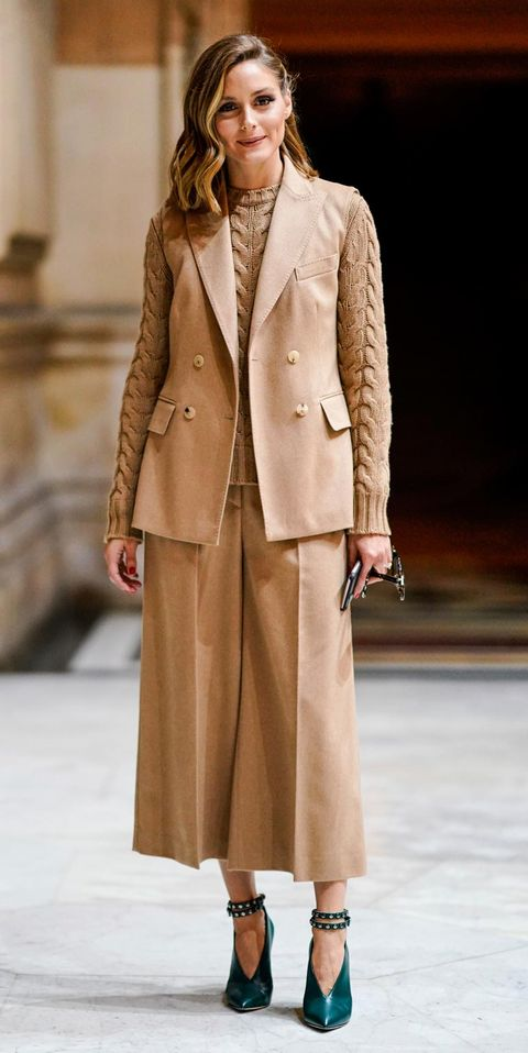 Fashion model, Clothing, Fashion, Fashion show, Overcoat, Outerwear, Coat, Runway, Beige, Human,