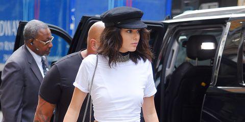Shirt, Suit, Fashion accessory, Waist, Vehicle door, Hat, Street fashion, Bag, Beige, Tie,