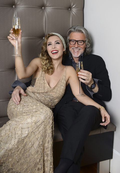Smile, Glasses, Trousers, Dress, Formal wear, Wine glass, Fashion accessory, Stemware, Drink, Cocktail dress,