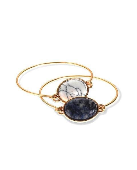 Jewellery, Amber, Fashion accessory, Body jewelry, Natural material, Circle, Gemstone, Locket, Pendant, Silver,