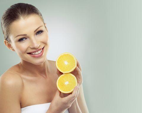 Skin, Citrus, Fruit, Natural foods, Tangerine, Orange, Eyelash, Logo, Beauty, Citric acid,