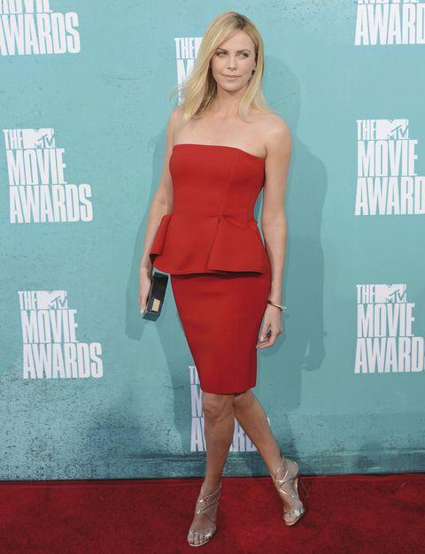 Dress, Shoulder, Red, Joint, Human leg, Style, Flooring, Waist, Fashion model, Cocktail dress,