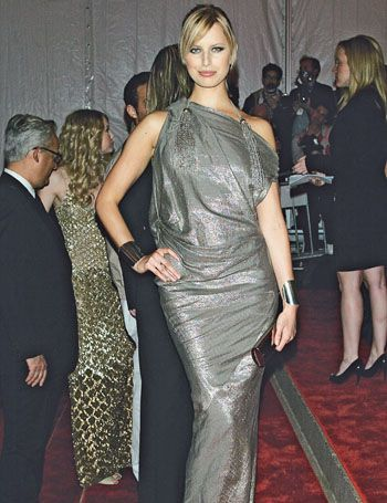 Clothing, Hair, Dress, Human body, Joint, Outerwear, Formal wear, Flooring, Coat, Style,