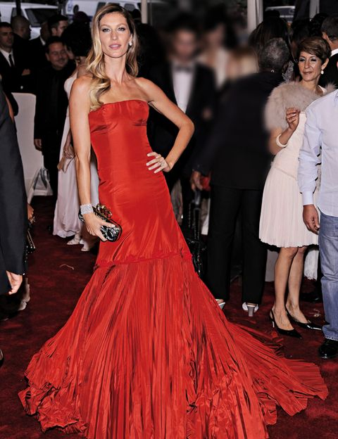 Clothing, Face, Dress, Event, Trousers, Shoulder, Red, Outerwear, Flooring, Strapless dress,