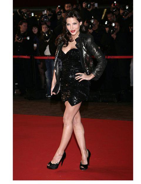 Human body, Dress, Shoulder, Shoe, Human leg, Flooring, Joint, Outerwear, High heels, Coat,