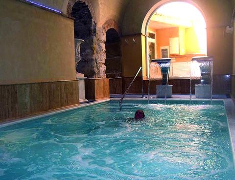 Swimming pool, Fluid, Liquid, Leisure, Floor, Arch, Aqua, Tile, Composite material, Reflection,