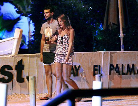 Human body, Dress, Bench, Thigh, Foot, Outdoor furniture, Bermuda shorts,