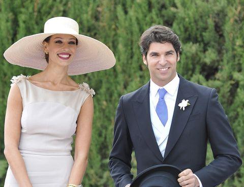 Smile, Coat, Shirt, Dress, Outerwear, Dress shirt, Happy, Formal wear, Suit, Hat,