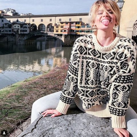Bangs, Sweater, Street fashion, Jewellery, Reflection, Pond, Blond, Necklace, Feathered hair, Woolen,