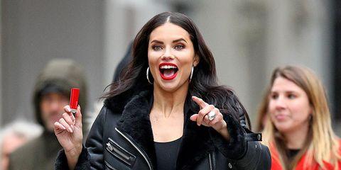 Mouth, Denim, Jacket, Fashion, Lipstick, Tooth, Gesture, Tongue, Street fashion, Leather,