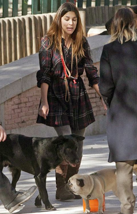 Human, Dog breed, Dog, Carnivore, Coat, Outerwear, Style, Street fashion, Plaid, Leash,