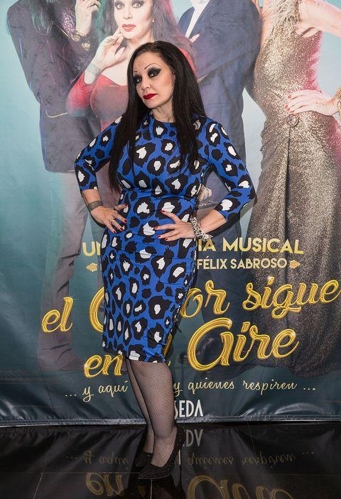 Formal wear, Fashion, Electric blue, Fashion model, Poster, One-piece garment, Day dress, Advertising, Long hair, Fashion design,
