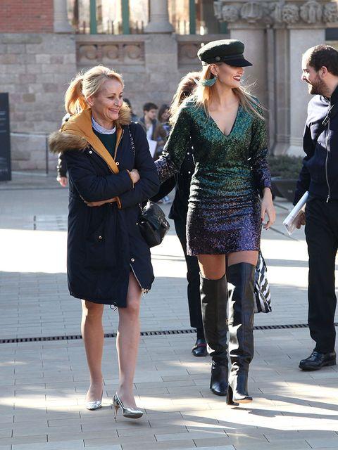 Clothing, Footwear, Leg, Trousers, Coat, Outerwear, Hat, Style, Street fashion, Dress,