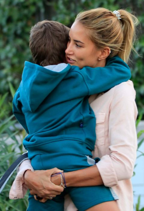 People in nature, Photograph, Blue, Green, Turquoise, Child, Interaction, Hug, Toddler, Outerwear,