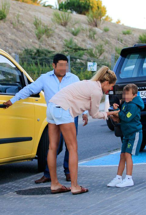 Yellow, Vehicle, Car, Vehicle door, Fashion, Street fashion, Pedestrian, Leg, Family car, Footwear,