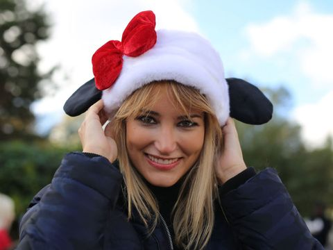 Smile, Jacket, Happy, Winter, Facial expression, Headgear, Costume accessory, Costume hat, Fur, Portrait photography,