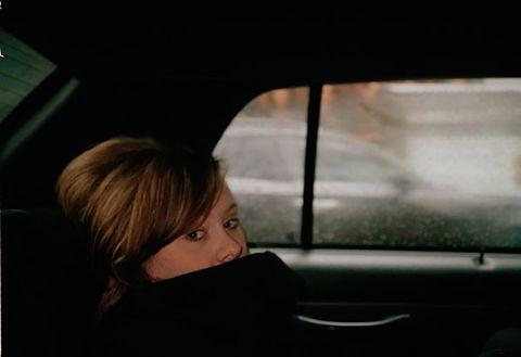 Glass, Vehicle door, Tints and shades, Eyelash, Automotive mirror, Windshield, Bangs, Automotive window part, Bob cut, Blond,