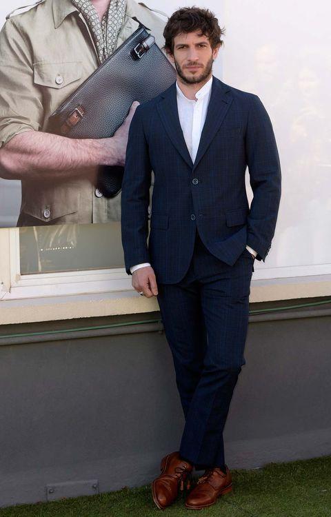 Suit, Clothing, Formal wear, Blazer, Tuxedo, White-collar worker, Outerwear, Footwear, Jacket, Shoe,
