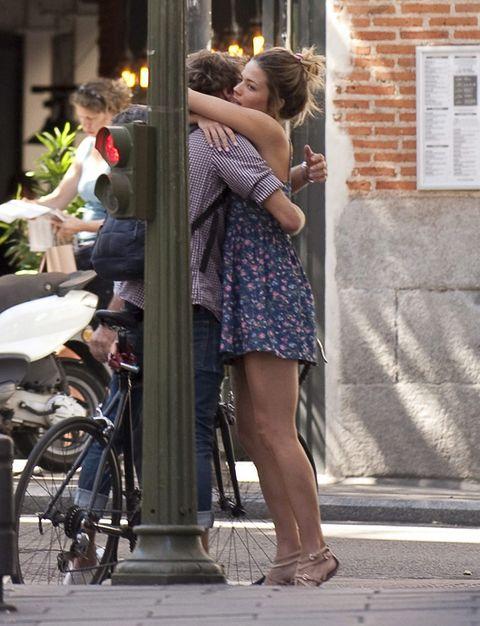 Dress, Bicycle wheel, Bicycle tire, Interaction, Bicycle, Romance, Street fashion, Love, Snapshot, Foot,