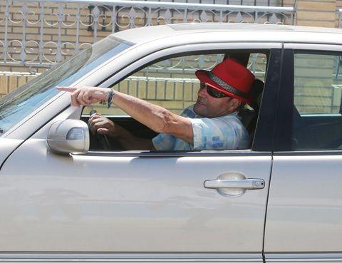 Land vehicle, Vehicle, Automotive exterior, Vehicle door, Hat, Car, Door handle, Automotive window part, Sun hat, Windshield,