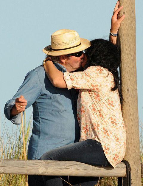 Hat, People in nature, Romance, Interaction, Love, Gesture, Denim, Kiss, Sun hat, Honeymoon,