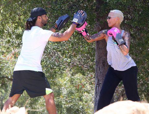 Arm, Cap, Elbow, People in nature, Glove, Active shorts, Trunks, Bermuda shorts, Baseball cap, Boxing equipment,