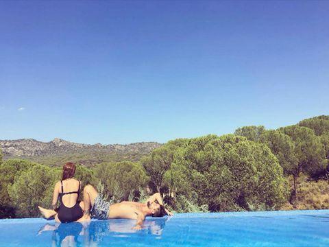 Body of water, Water, Swimwear, Leisure, Swimsuit top, Summer, Tourism, Vacation, Bikini, Undergarment,