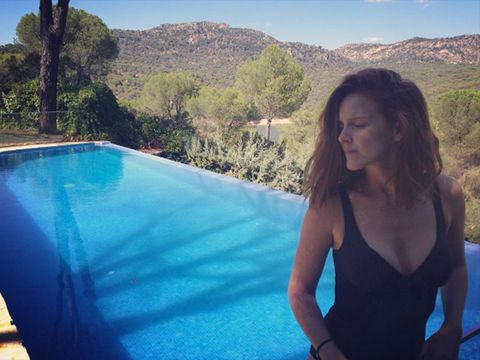 Swimming pool, Leisure, Azure, Hill, Long hair, Aqua, Composite material, Chest, Brown hair, Waist,
