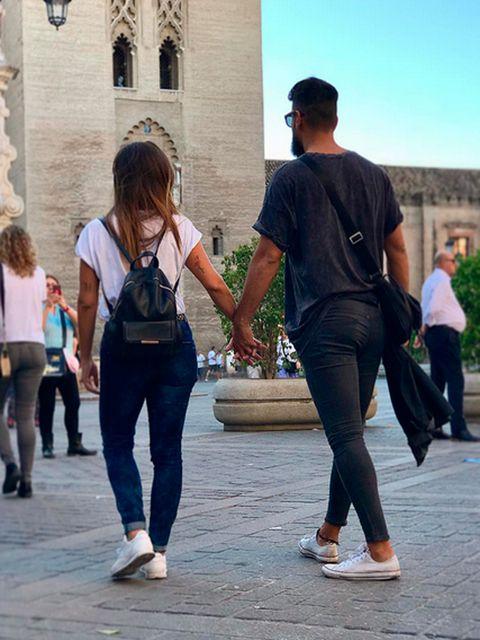 Jeans, Tourism, Snapshot, Fashion, Walking, Footwear, Leg, Interaction, Pedestrian, Street fashion,