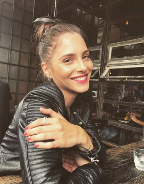 Hair, Hairstyle, Smile, Blond, Leather, Leather jacket, Jacket, Textile, Photography, Long hair,