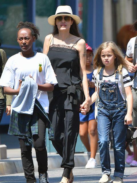 People, Street fashion, Fashion, Snapshot, Sunglasses, Human, Footwear, Eyewear, Leg, Infrastructure,