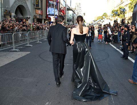 Trousers, Coat, Dress, Crowd, Outerwear, Suit, Formal wear, Style, Gown, Fashion,