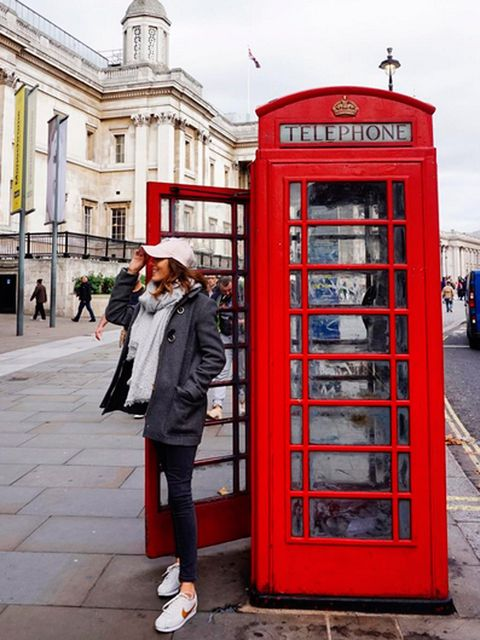 Telephone booth, Payphone, Telephony, Red, Human settlement, Public space, Telephone, Urban area, City, Outdoor structure,