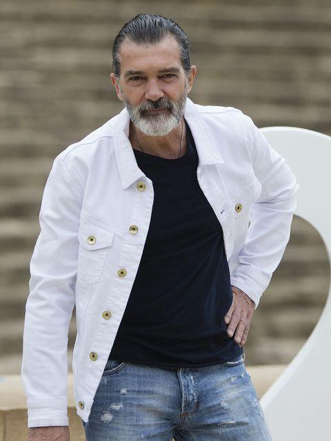 White, Facial hair, Beard, Dress shirt, Outerwear, Jeans, Jacket, Denim, Moustache, Shirt,