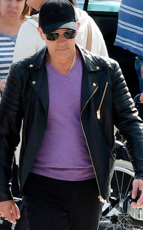 Jacket, Eyewear, Sunglasses, Leather jacket, Leather, Textile, Outerwear, Headgear, Top, Jeans,