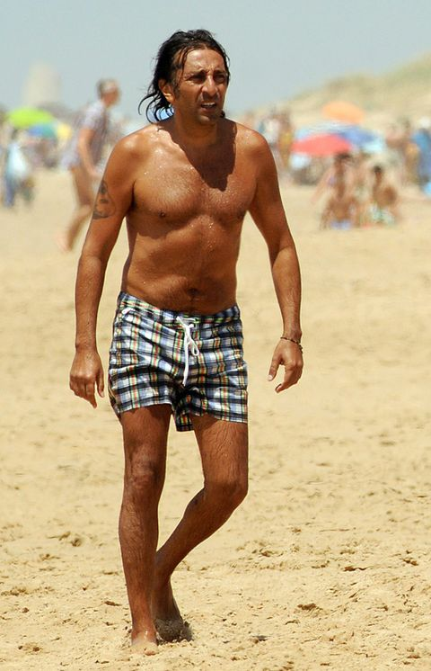 Sand, Human leg, board short, People on beach, Mammal, Trunks, People in nature, Summer, Facial hair, Barechested,