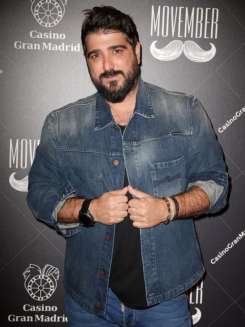 Denim, Facial hair, Jeans, Cool, Beard, Muscle, Textile, Gesture, Style,