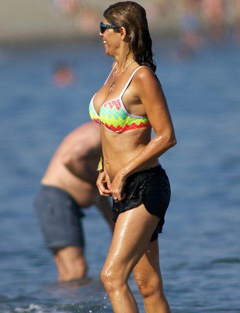 Clothing, Brassiere, Human body, Human leg, Summer, Bikini, Swimsuit top, Undergarment, Chest, Thigh,