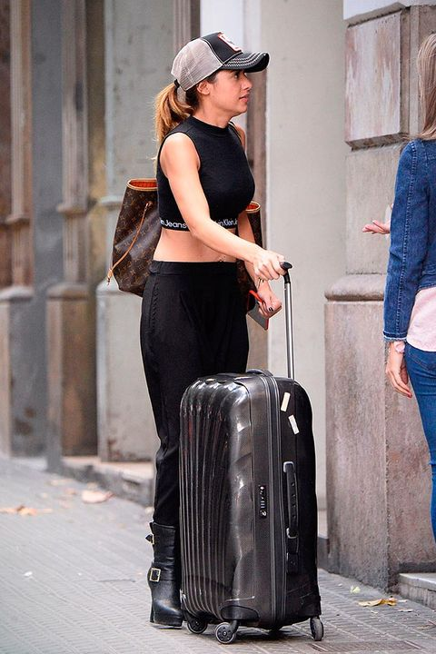 Street fashion, Fashion, Suitcase, Hand luggage, Street, Leg, Leather, Baggage, Jeans, Luggage and bags,