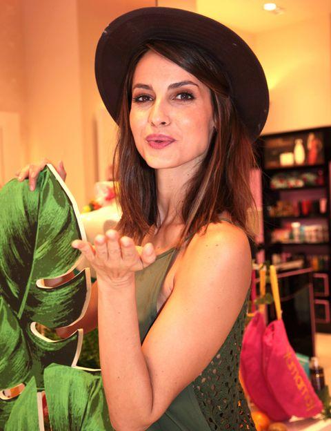 Hat, Shelf, Costume accessory, Headgear, Sun hat, Shelving, Long hair, Photo shoot, Fedora, Costume hat,